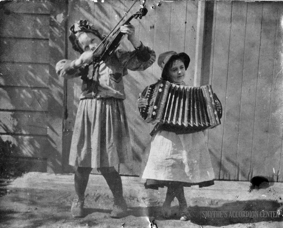Vintage accordion children playing